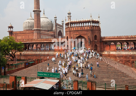 People leaving the Jama Masjid (Friday Mosque) after the Friday Prayers, Old Delhi, Delhi, India, Asia - Stock Photo