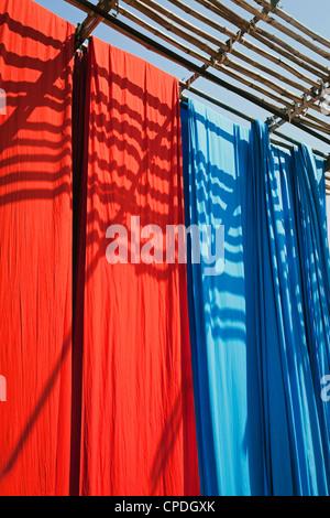 Freshly dyed fabric hanging to dry, Sari garment factory, Rajasthan, India, Asia - Stock Photo