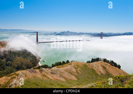 Golden Gate Bridge and the San Francisco skyline floating above the fog on a foggy day in San Francisco, California, - Stock Photo