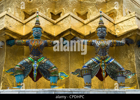 Statues of demons on the Golden Chedi, Wat Phra Kaeo Complex (Grand Palace Complex), Bangkok, Thailand, Southeast - Stock Photo
