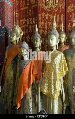 Buddha statues in the Funerary Carriage Hall, Wat Xieng Thong, Luang Prabang, Laos, Indochina, Southeast Asia, Asia - Stock Photo