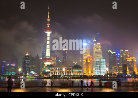 Pudong skyline at night across the Huangpu River, Oriental Pearl tower on left, Shanghai, China, Asia - Stock Photo