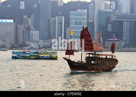 Star ferry and Chinese junk boat on Victoria Harbour, Hong Kong, China, Asia - Stock Photo