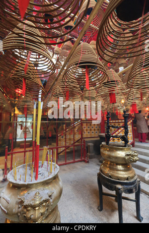 Incense coils hang from the roof of the Man Mo Temple, built in 1847, Sheung Wan, Hong Kong, China, Asia - Stock Photo