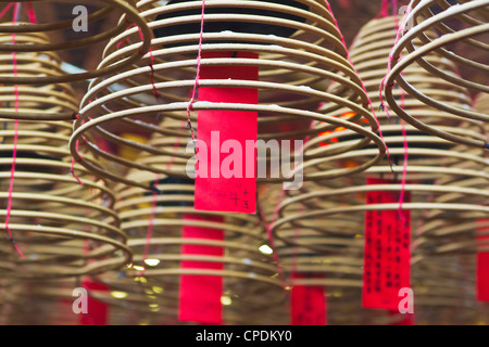 Incense coils and prayers written on red tags in the Man Mo Temple, Hong Kong, China, Asia - Stock Photo