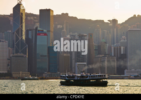 Star Ferry crossing Victoria Harbour towards Hong Kong Island, Hong Kong, China, Asia - Stock Photo