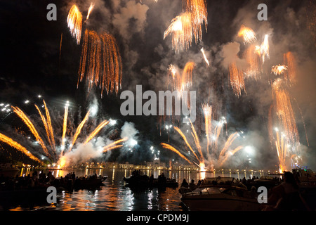 The amazing fireworks display during the night of Redentore celebration in the basin of St. Mark, Venice, Veneto, - Stock Photo