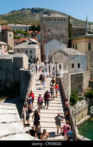 Tourists on Stari Most (Old Bridge), UNESCO World Heritage Site, Mostar, municipality of Mostar, Bosnia and Herzegovina, - Stock Photo