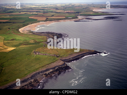 Aerial view of Embleton Bay, Castle Point and ruins of Dunstanburgh Castle on the Northumberland coast - Stock Photo