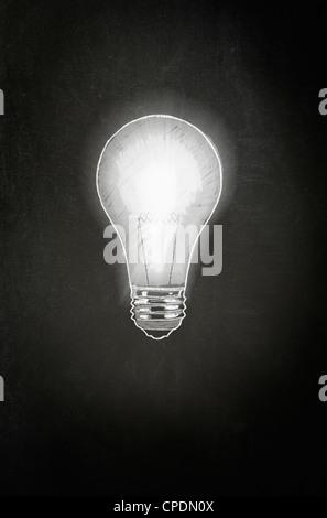 A Light Bulb drawn in white chalk on a blackboard - Concept - Stock Photo
