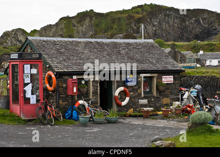 Ferry waiting room and phone box Easdale Island a slate island near Oban in the west Highlands of Scotland - Stock Photo