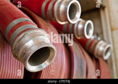 Close up fire hose of fire truck - Stock Photo
