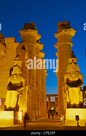 Great Court of Ramesses II and colossal statues of Ramesses II, Temple of Luxor, Thebes, Egypt, Africa - Stock Photo