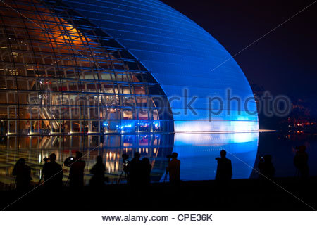 National Centre for the Performing Arts, illuminated in blue light at night during National Day Festival, Beijing, - Stock Photo