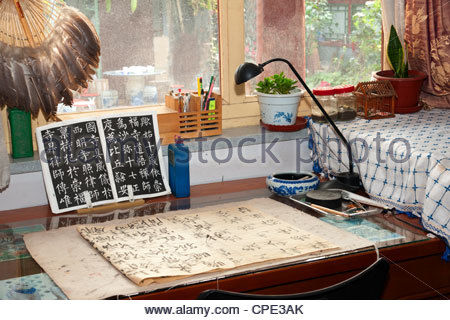 Calligraphy artist's desk, Xiaojinsi Hutong district, Beijing, China, Asia - Stock Photo