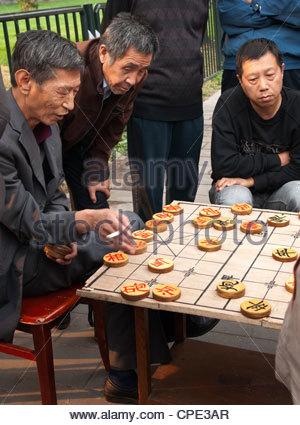 Men playing Chinese chess, Beijing, China, Asia - Stock Photo