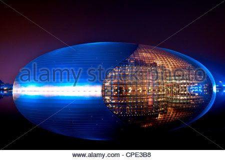 National Centre for the Performing Arts, egg shape reflection, illuminated during National Day Festival, Beijing, - Stock Photo