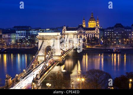 Chain Bridge and St. Stephen's Basilica at dusk, UNESCO World Heritage Site, Budapest, Hungary, Europe - Stock Photo