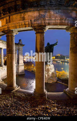 Gellert Monument with view over River Danube and city at dusk, Gellert Hill, Budapest, Hungary, Europe - Stock Photo