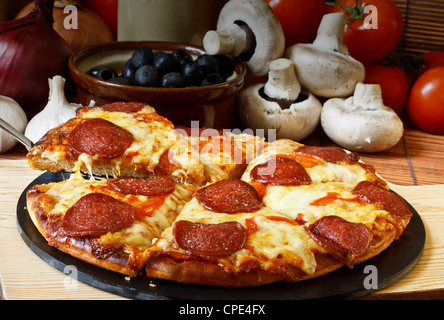 Pepperoni and Cheese Pizza - Stock Photo