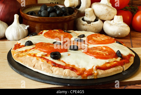 Neopolitan or plain mozzarella cheese and tomato pizza - Stock Photo