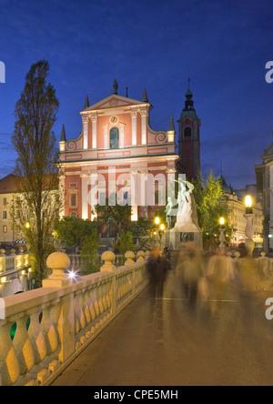 The Church of the Annunciation and Triple Bridge on the Ljubljanica River at dusk, Ljubljana, Slovenia, Europe - Stock Photo