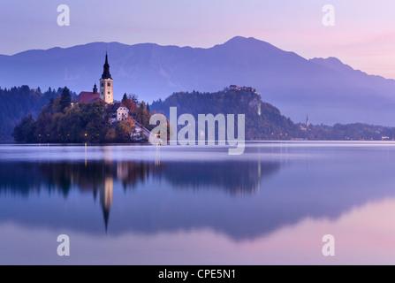 Blejski Otok Island on Lake Bled at dawn in autumn, Bled, Gorenjska, Slovenia, Europe - Stock Photo