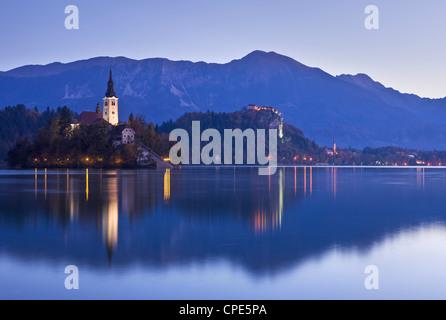 Blejski Otok Island on Lake Bled at dawn in autumn, Gorenjska, Slovenia, Europe - Stock Photo