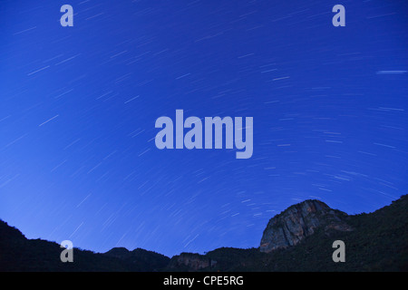 Star trails at dusk above Mount Nyiru, Northern Frontier, Kenya, East Africa, Africa - Stock Photo