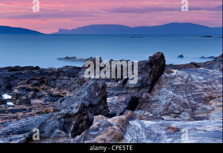 Sunset over Skye from the Isle of Eigg, Inner Hebrides, Scotland, United Kingdom, Europe - Stock Photo