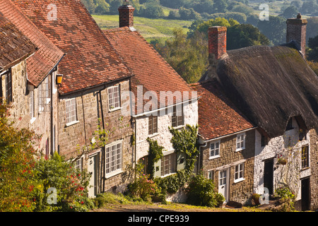 The famous cobbled street of Gold Hill in Shaftesbury, Dorset, England, United Kingdom, Europe - Stock Photo