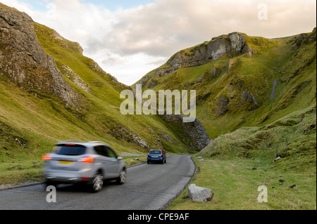 Cars travelling down Winnats Pass, Castleton, Peak District National Park, Derbyshire, England, United Kingdom, - Stock Photo