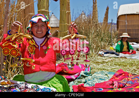 Portrait of a Uros Indian woman selling souvenirs, Islas Flotantes (Floating Islands), Lake Titicaca, Peru, South - Stock Photo