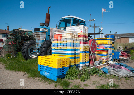 Fisherman's tractor and empty ice boxes, Caister On Sea, Norfolk, England - Stock Photo