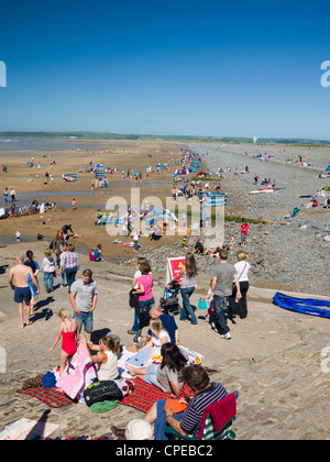 A busy beach on a Bank Holiday at Westward Ho!, Devon, England. - Stock Photo