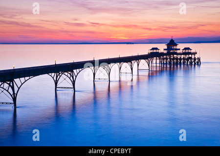 The sun sets over the Bristol Channel behind the Pier at Clevedon, Somerset, England, UK - Stock Photo