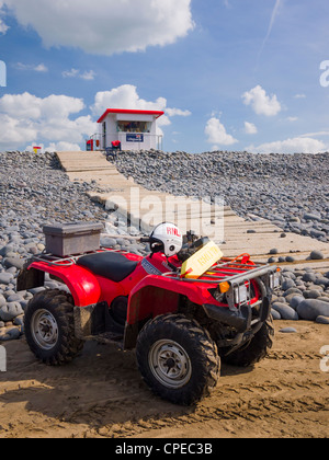 A lifeguard's quad bike on the beach at Westward Ho!, Devon, England. - Stock Photo