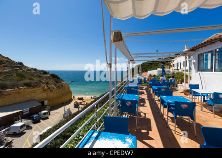 Terrace of a cafe overlooking the beach in the village of Benagil on the coast between Portimao and Albufeira, Algarve, - Stock Photo
