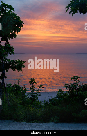 Sunset at Guludo beach lodge in the Quirimbas National Park in northern Mozambique. - Stock Photo