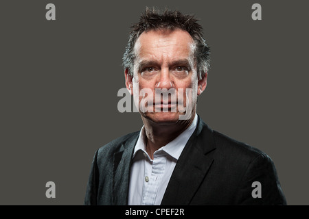Portrait of Middle Age Business Man in Suit High Contrast Look on Grey Background - Stock Photo