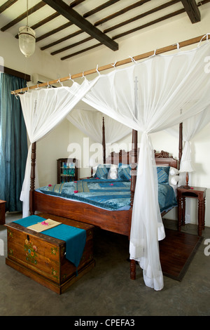 Bedroom of the Ibo lodge on Ibo island in the Quirimbas archipelago off the coast of northern Mozambique. - Stock Photo