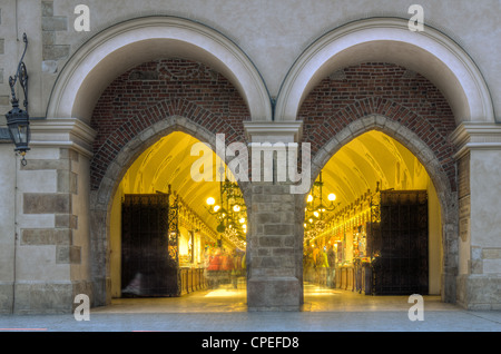 Passage with artistic craft souvenir stalls of the gothic cloth hall Sukiennice on the Main Market Square in Krakow. - Stock Photo