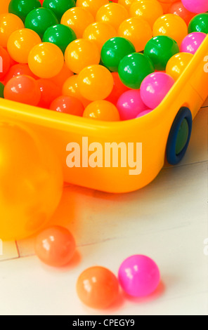 Toy Vehicle Filled With Multicolored Balls - Stock Photo