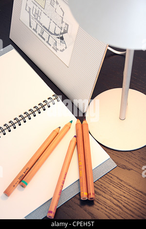 Good Idea Drawing Book Color Pencils And Lamp On Table