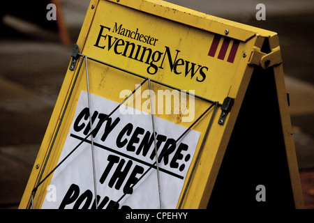 MEN Manchester Evening News yellow A-frame newsstand - Stock Photo