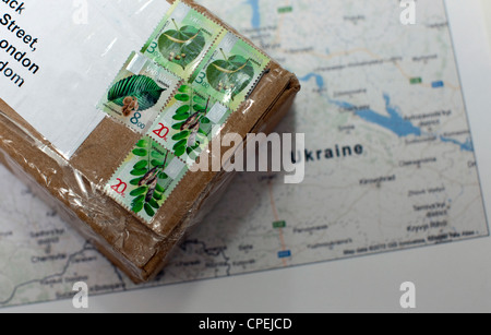 Stamps on packet from Ukraine - Stock Photo