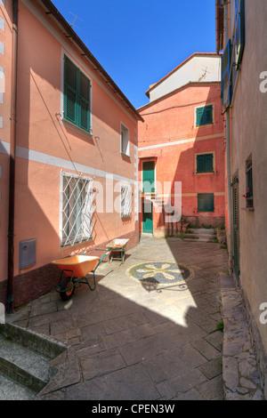 characteristic small square in San Rocco di Camogli, Liguria, Italy. Image processed with hdr technique - Stock Photo