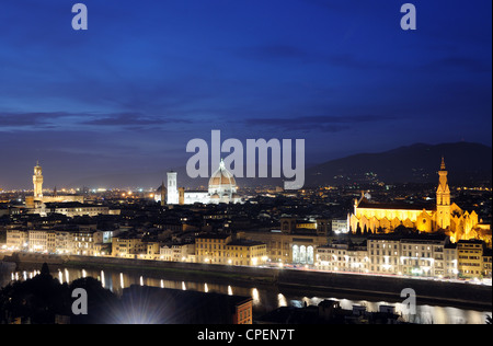 The Florentine skyline, including the Cathedral, Palazzo Vecchio & Basilica di Santa Croce, at dusk in Florence, - Stock Photo