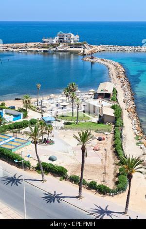 Sea shore and embankment in the city of Monastir, the Mediterranean Sea, Tunisia - Stock Photo