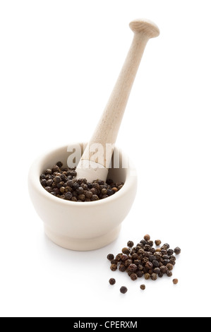 black peppercorns in a white pestle and mortar isolated - Stock Photo